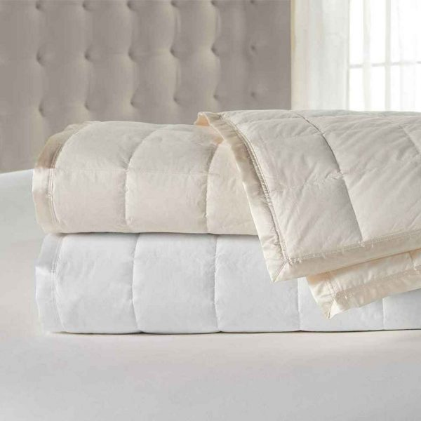 Downlite blanket filled with duck down and available in ivory or white color